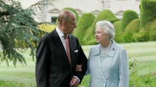 Queen Elizabeth and Prince Philip in almost the same spot and pose, 60 years later.