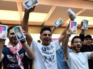 First customers display their iPhone X purchases at Apple's flagship Sydney store on launch day. Picture: AFP PHOTO / SAEED KHAN