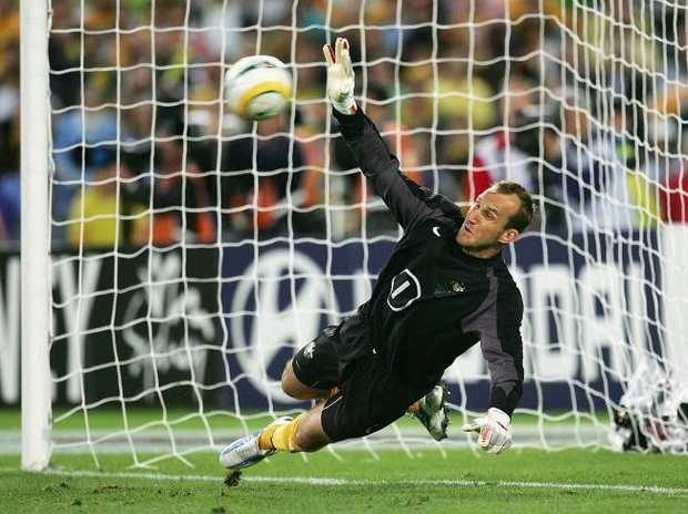 Mark Schwarzer of the Socceroos makes a save in the penalty shoot-out against Uruguay in 2005.