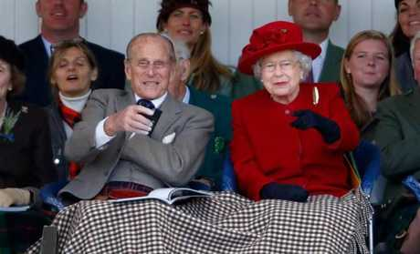 Prince Philip, Duke of Edinburgh, and Queen Elizabeth II get cosy. Picture: Getty Images