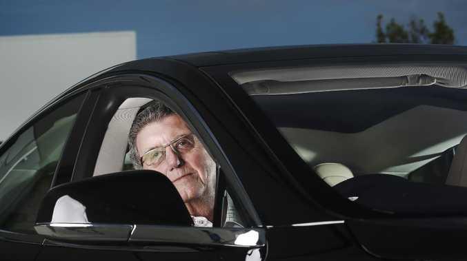 Trevor St Baker in an electric Tesla car. Picture: Mark Cranitch.