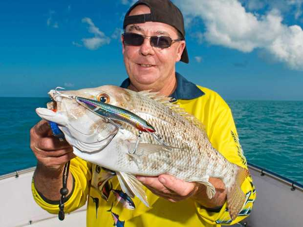 Wayne Phillips with a nice sweetlip landed while on charter with Reel Addiction Sport Fishing.