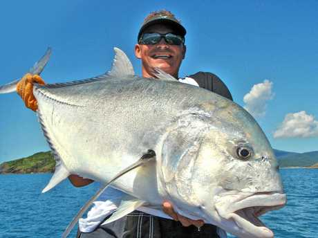 Ash Matthews of Sea Fever Sportfishing with an impressive GT caught in the Whitsundays.