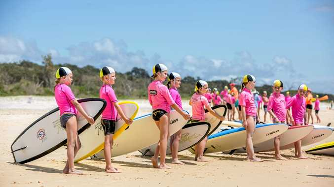 GET READY: Nippers line up with their boards to enter the water on a beautifully blue day on the Cooloola Coast.