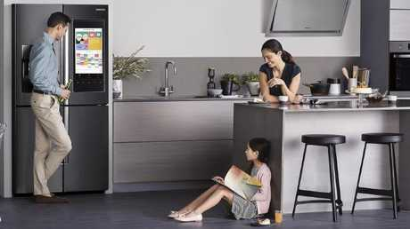 Samsung's latest Family Hub smart fridge features a touchscreen, Woolworths app, and voice recognition. Picture: Supplied
