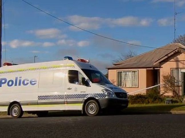 Police outside the house where three-year-old Joseph was tortured and killed over seven weeks in 2014. Picture: Ten News.