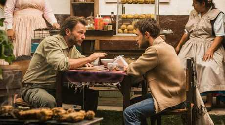 [Thomas Kretschmann as Karl Ruchprecter and Daniel Radcliffe as Yossi Ghinsberg in Jungle.