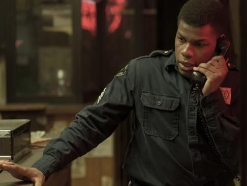 John Boyega's security guard Dismukes walks the between collusion and mediation in Detroit.