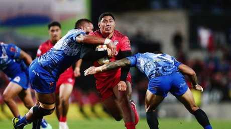 Jason Taumalolo on the charge for Tonga against Samoa at Waikato Stadium.