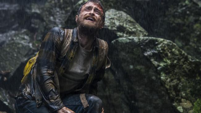 A bruised and bleeding Yossi Ghinsberg (Daniel Radcliffe) as the trip of a lifetime goes horribly wrong in Jungle.