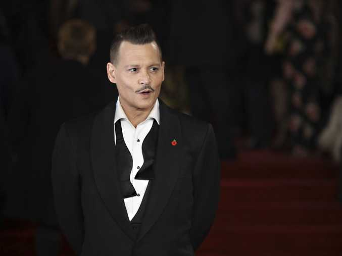 Actor Johnny Depp poses for photographers upon arrival at the World premiere of the film 'Murder On The Orient Express'.