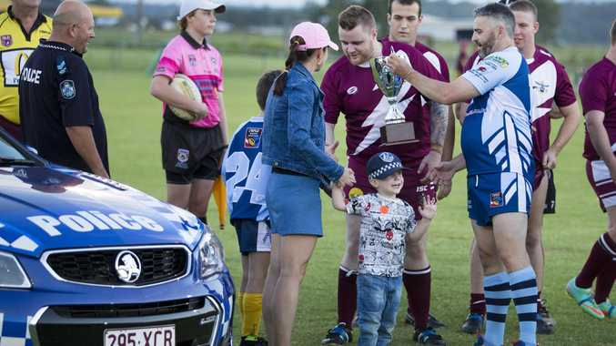 MOVING TRIBUTE: Susan Forte and sons Brodie and Sam were escorted onto the field to deliver the Brett Forte Memorial Cup on Saturday.
