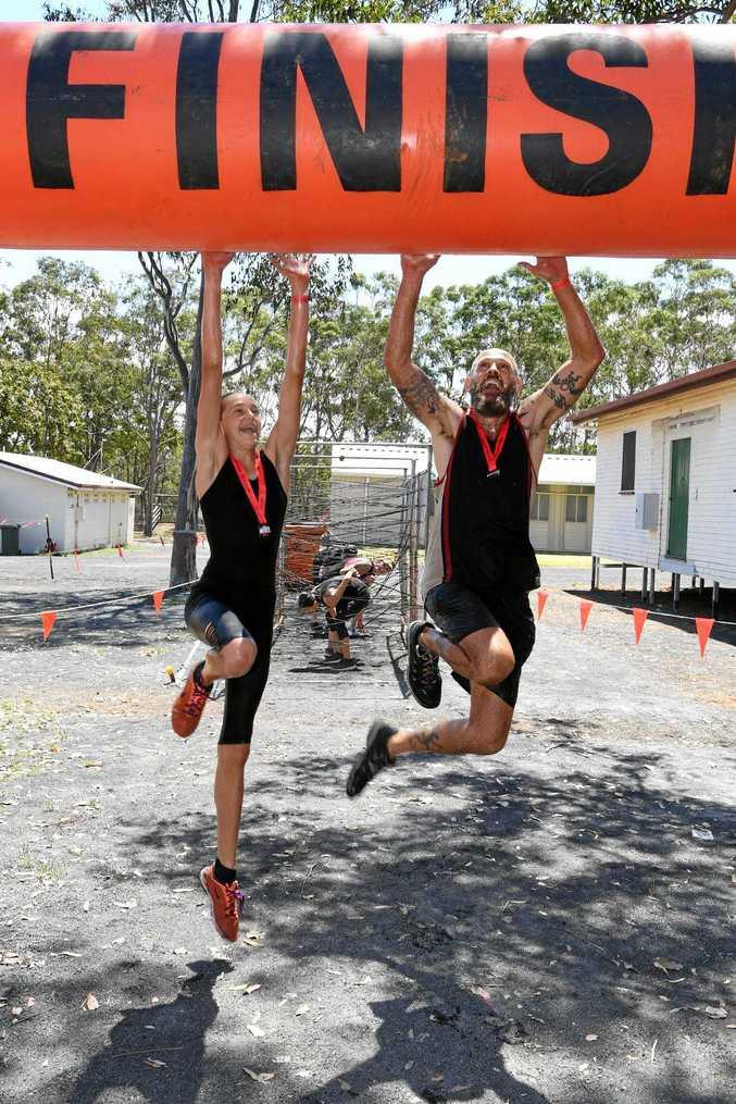 FINISH LINE: Alex Whitaker and Zanzibar Buck-Buck McFizz at the Obstacle Hell course at the Bundaberg Recreational Precinct.
