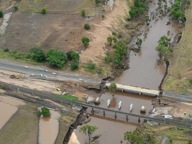 More than a third of the Capricorn Highway fails a safety test as state's motoring body calls for upgrades. Pictured is the Neerkol Bridge, Capricorn Highway following heavy rain Australia Day, 2013.