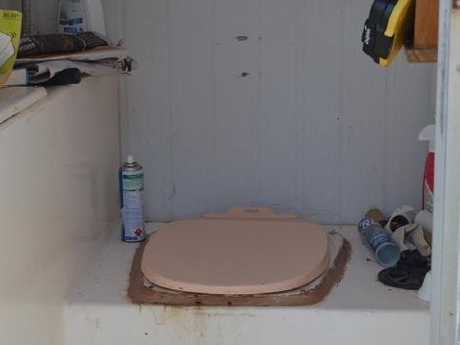 Jason paul's loo is a rudimentary affair outside his home. Picture: Benedict Brook