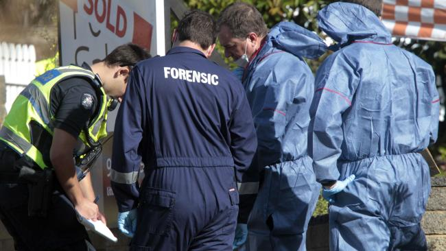 Police and forensic investigators at the scene of the incident. Picture: Richard Serong