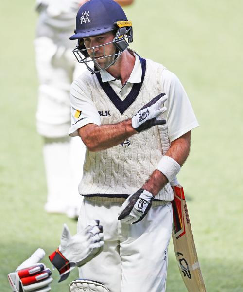 Glenn Maxwell throws his gloves after he is dismissed on Sunday.