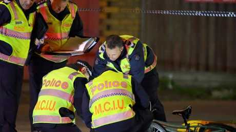 Police at the scene of a hit-run that left a teenage cyclist with critical injuries. Picture: Patrick Herve