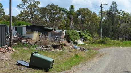 Some streets in West Wyee have electricity. None have piped water, sewerage, sealed roads or guttering. Almost every dwelling is illegal. Picture: Benedict Brook