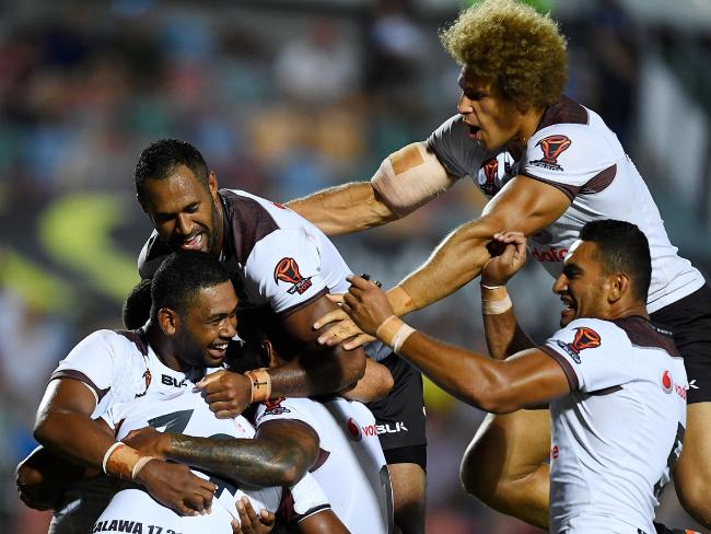 Fijian players celebrate the try of Joe Lovodua.