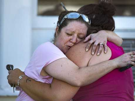 Carrie Matula embraces a woman after a fatal shooting at the First Baptist Church in Sutherland Springs, Texas, on Sunday, Nov. 5, 2017. Matula said she heard the shooting from the gas station where she works a block away.