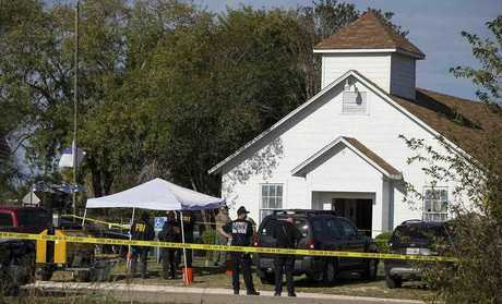 Description: Law enforcement officials works at the scene of a fatal shooting at the First Baptist Church in Sutherland Springs, Texas, on Sunday, Nov. 5, 2017. (Nick Wagner/Austin American-Statesman via AP)