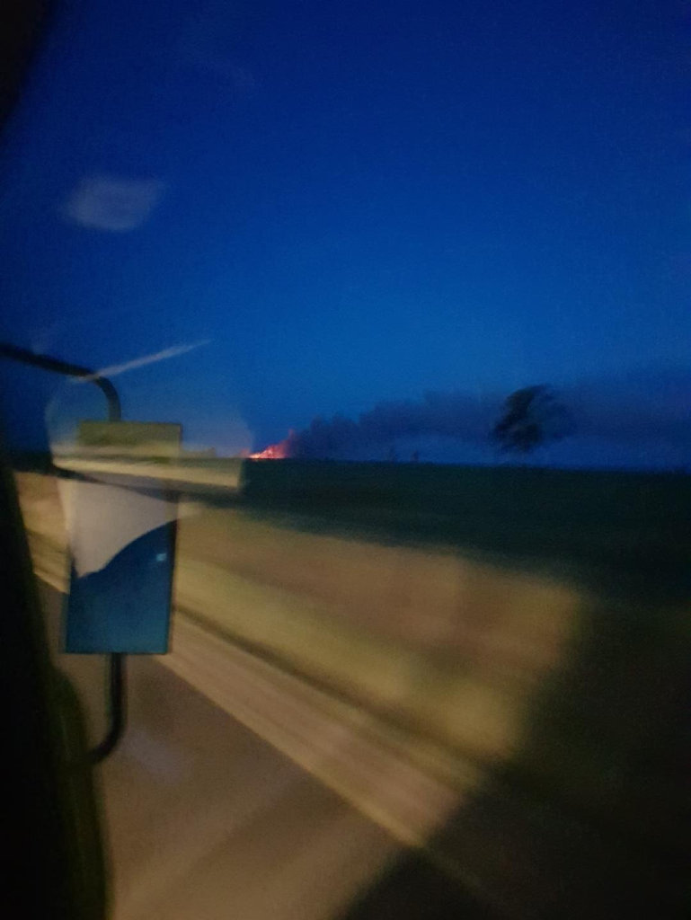 Firefighters rush to a bushfire at Bells Creek.
