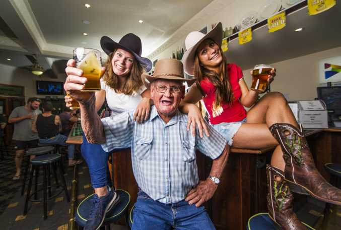 Patrons Sabrina Luppers (left) and Chanel Girak (right) with local Gordon Fleming who runs the Beers and Bullsh#t tours of the historic Victoria Hotel in Goondiwindi.