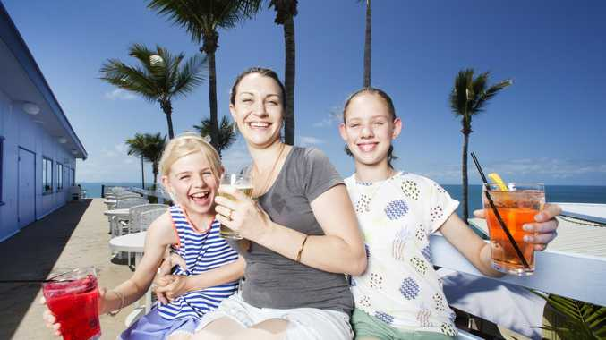 Amanda Collins with her neices Felicity and Taitum McConville from Mackay enjoy a cold beverage and a stellar ocean view at the Eimeo Pacific Hotel near Mackay.