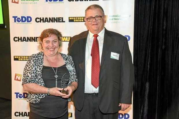 STATE AWARD: Linda Harris from New Extra Hooper Centre won Queensland Newsagent Employee of the Year, presented by GNS regional sales manager Stephen Melville.