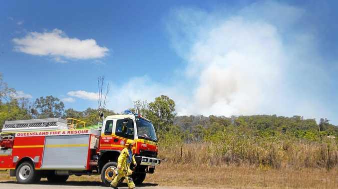 Firefighters kept a close eye on this bushfire burning in dense scrub near Bentleys Road, Homebush.   Photo Tony Martin / Daily Mercury
