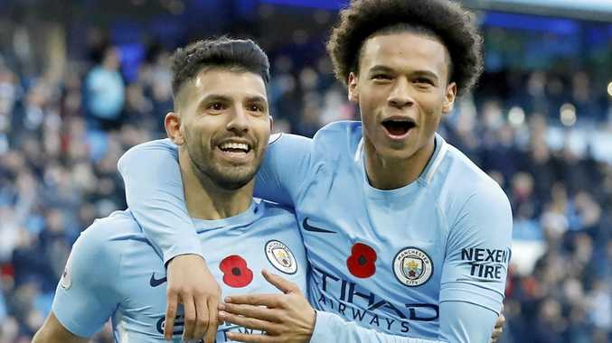 Manchester City's Sergio Aguero, left, celebrates scoring his side's second goal with teammate Leroy Sane in the 3-1 win over Arsenal.