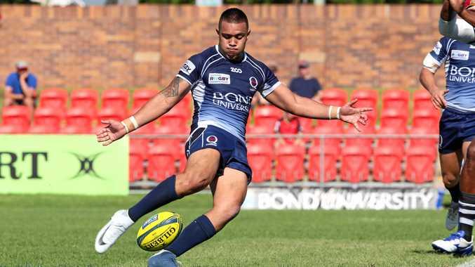 Queensland Country captain Duncan Paia'aua kicks ahead during the NRC semi-final against the Fijian Drua.