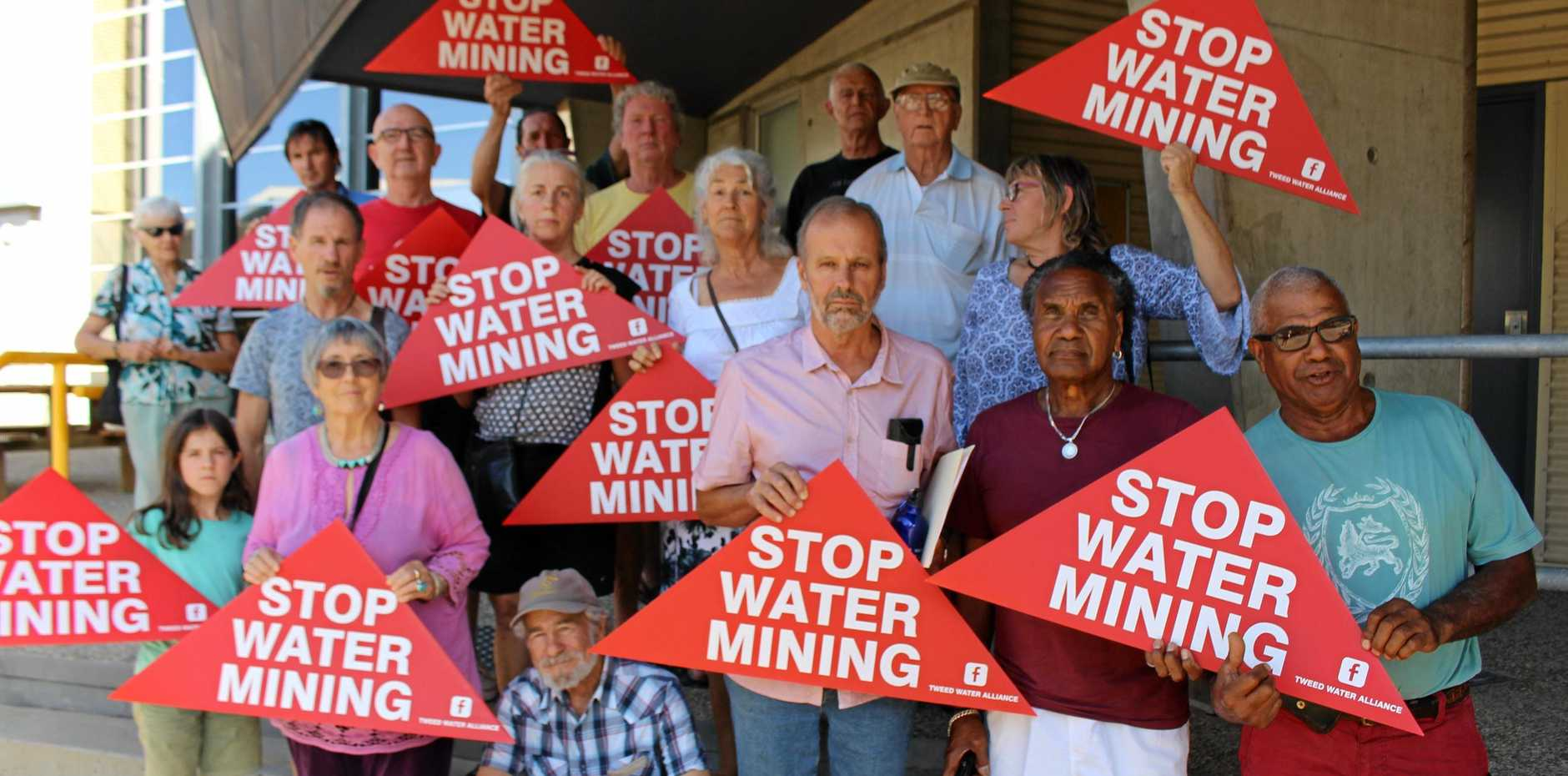 DIGGING IN: Protesters gather outside Tweed Shire Council on Thursday opposing a development application  to commercially extract water from a Uki property.