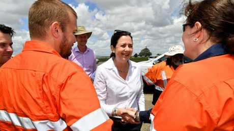Premier Annastacia Palaszczuk (centre) is seen meeting workers on the Bruce Highway upgrade in Mackay. Picture: AAP/Darren England