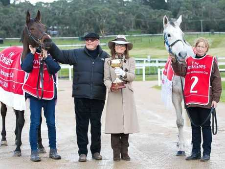 Reigning Melbourne Cup champion Almandin, owner Lloyd Williams, VRC chairman Amanda Elliott and 2007 winner Efficient at Macedon Lodge this year. Picture: Karon Photography