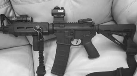 """Kelley, who was married, had recently posted a photo of an AR-15 style gun on his Facebook page with the caption: """"She's a bad b***h""""."""