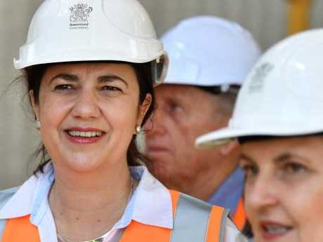 Queensland Premier Annastacia Palaszczuk (left) is seen inspecting the building of the new Mackay Fire Station. Picture: AAP/Darren England