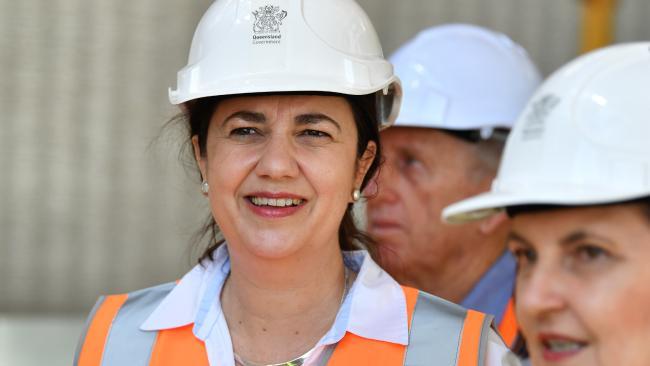 Queensland Premier Annastacia Palaszczuk (left) is seen inspecting the building of the new Mackay Fire Station. Picture: AAP/Darren England