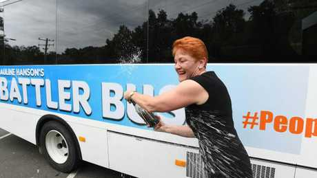 "One Nation Leader Pauline Hanson is seen popping a bottle of champagne on the ""Battler Bus"". Picture: AAP/Dave Hunt"