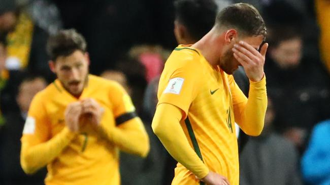 James Troisi and the Socceroos react at full time.