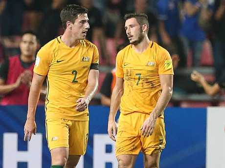 Mathew Leckie (R) is one of those suspended for the first leg.
