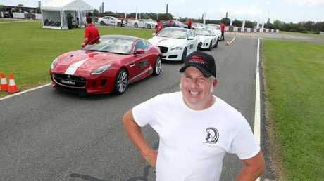 Paul Morris with some of the $4 million-plus worth of cars at the event. Photo: Richard Gosling