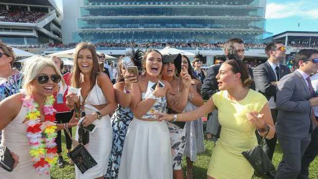 Melbourne Cup Carnival.Oaks Day.The sun shines again as these punters cheer home their winner in the Crown Oaks.Picture:Ian Currie