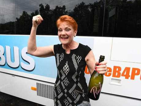 One Nation leader Pauline Hanson is seen after popping a bottle of sparkling wine before boarding the One Nation 'Battler Bus' in Brisbane, Monday, November 6, 2017.