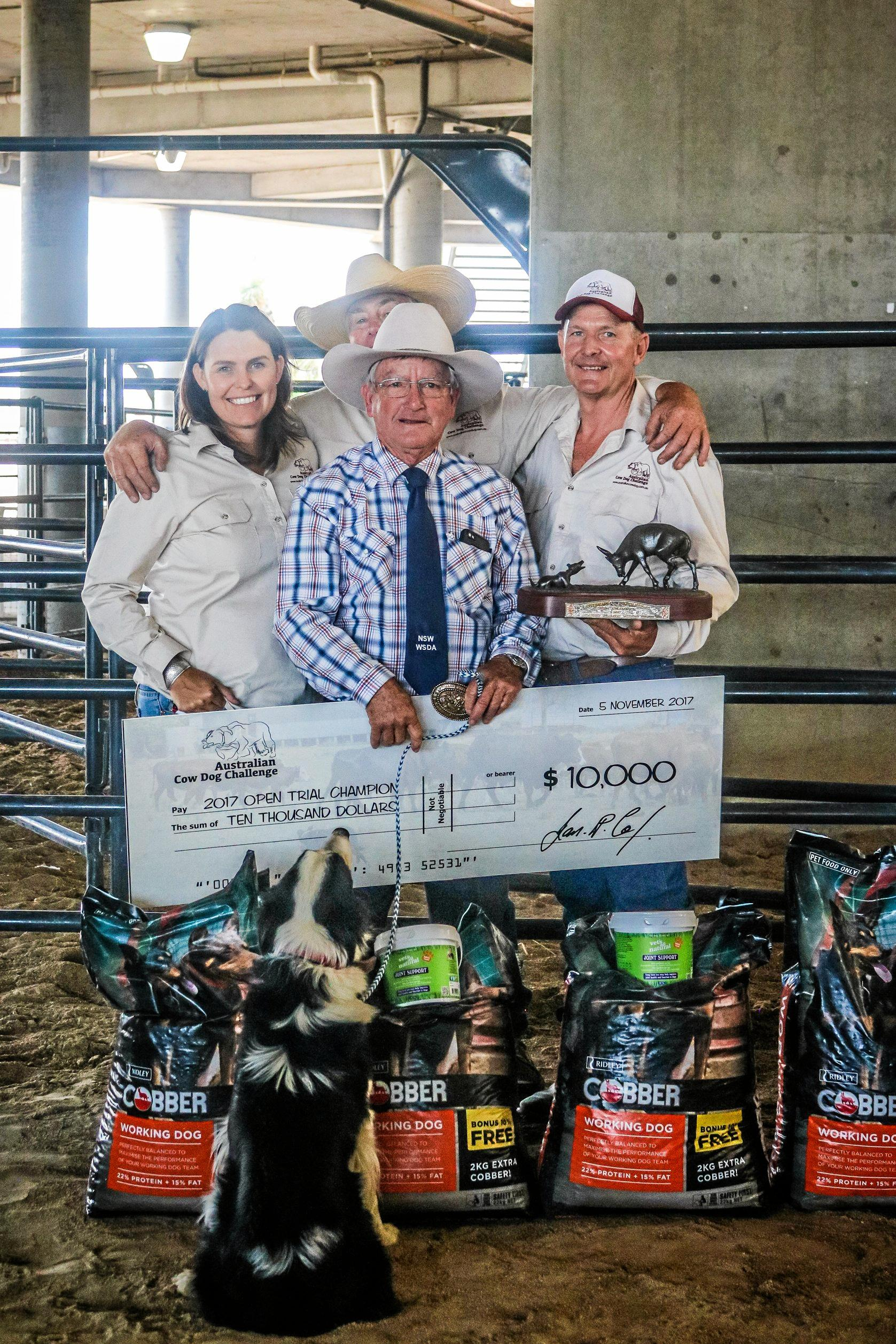 CHAMPION EFFORT: Robert Johnston with his winning cheque, with Australian Working Cow Dog organisers Ian Cox, Tim McVey and Maree Balmain.