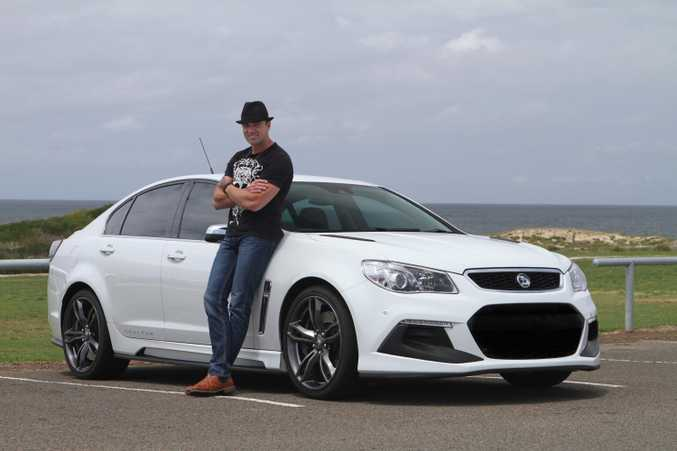 Australian singer Shannon Noll with his HSV Senator.