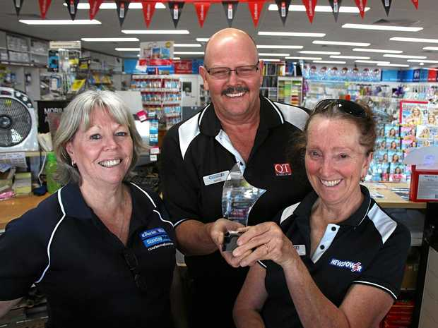 GRINNERS: David and Jenny Keys celebrate their   award with employee Julie.