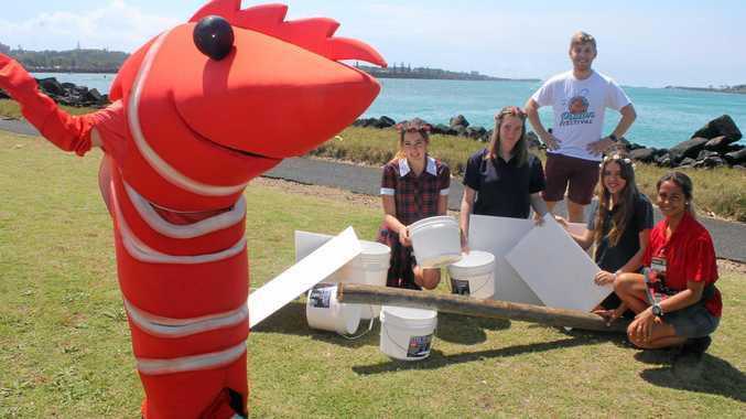 PRAWN FESTIVAL: Ballina Junior Chamber of Commerce members (from left) Sofia Spina-Crummy, Ruby de Plater, Lucas Carter and Jamaika Smith get in some practice for Saturday's raft-building competition with help from Courtney Dunlop of Bunnings and Ballina's Prawn.