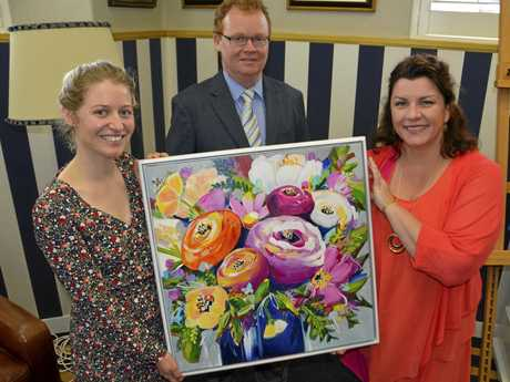 With an artwork created in honour of St Mary's teacher Robyn Chantler, who died of ovarian cancer, is Robyn's daughter Emily Chantler, St Mary's College principal Michael Newman and artist Anna Bartlett.